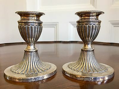 A Pair Of Georgian Style Silver Fluted Candlesticks, Sheffield 1892. 10.5cm.