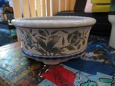 Ceramic Bowl with Blue border trim and green flower art work.