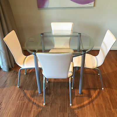 Glass dining table and chairs excellent condition aud for Prem table 99 00