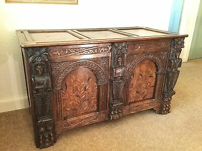 Unique antique large joined oak coffer with inlayed panels and 3 carved figures