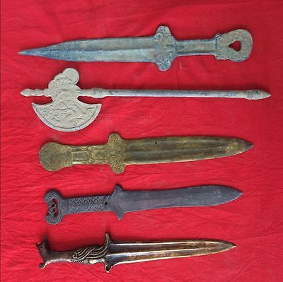 Five pieces of weapon in ancient China: four bronze sword and a bronze axe.