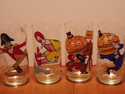 SET OF 4 McDONALDS COLLECTOR GLASSE ACTION SERIES RONALD,CROOK,MCCHEESE,BIG MAC