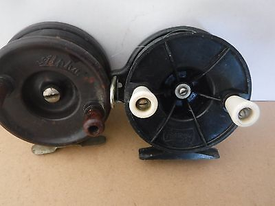 Two old fishing reels