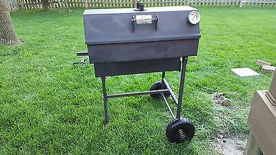 BBQ Smoker - Good One Open Range in good condition with new no flat wheels.