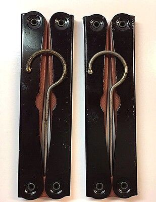 Two vintage pink & black folding clothes hangers. Marked England. Ships free!