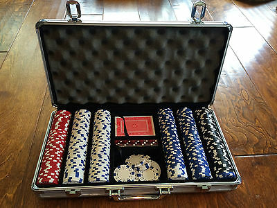Heavy duty poker case with 300 chips, dice, cards and dealer card, foam inside