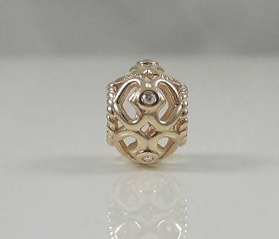 Genuine Pandora 14K solid gold charm with genuine Diamonds only gently used