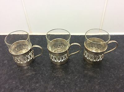 Solid silver cup holders with glass cups. Birmingham