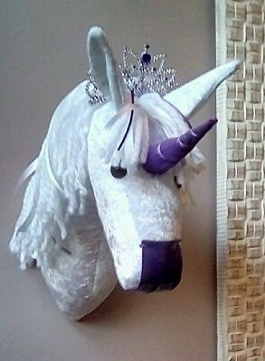 faux taxidermy trophy head unicorn wall hanging with purple acsents