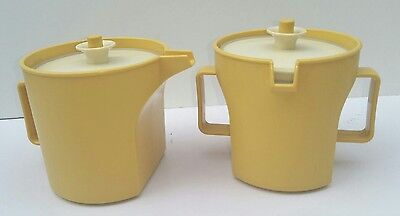 Two Vintage Tupperware yellow jug cups with press seal push top lids Small