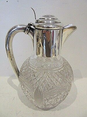 A Victorian Silver Mounted Claret Jug, London 1899.