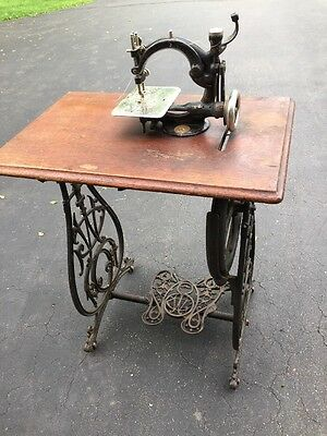 Antique Wilcox And Gibbs Treadle Sewing Machine including table and treadle base