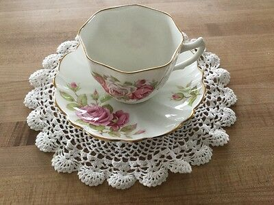 Victoria C & E Rose with gold trim teacup and saucer from England Bone China