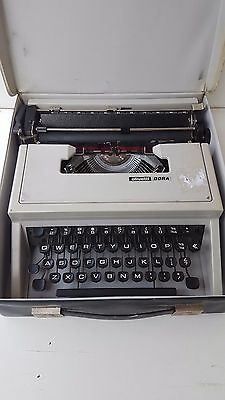 olivetti dora portable typewriter with plastic carry case