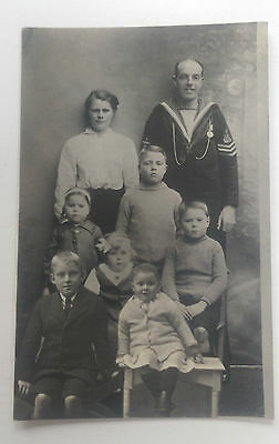 WW1 Real Photo Postcard Royal Navy Sailor with Medal and Family - Unusual Style