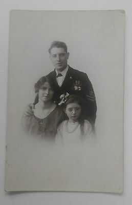 WW1 Real Photo Postcard Royal Navy Sailor with Star Trio Medals