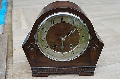 Small German mantel clock with time strike.