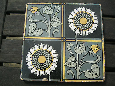 Antique tile mainly black  and green .bold design