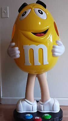 """Yellow Peanut M&M character candy display 42"""" tall on wheels, LOCAL PICKUP ONLY"""