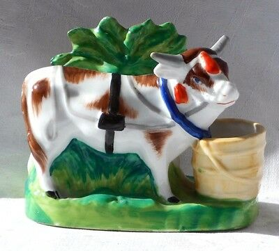 A Cow On A Plinth With Brocage And A Milk Bucket In Vibrant Colours