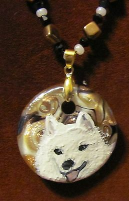 American Eskimo hand painted on a round Murano glass pendant/bead/necklace