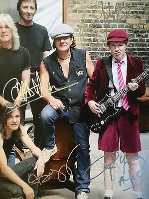 Authentic AC/DC Hand signed photo 8 x 10 W/COA Brian Angus Cliff Stevie