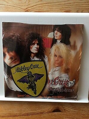 """MOTLEY CRUE-Dr. FEELGOOD 7"""" with patch .1989 WEA LABEL SEALED"""