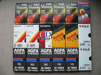 Eighteen used E180 VHS video tapes.