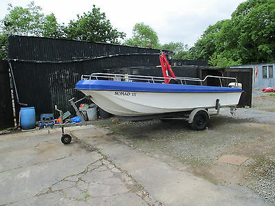17 ft dory boat and trailer with 5 h.p engine.
