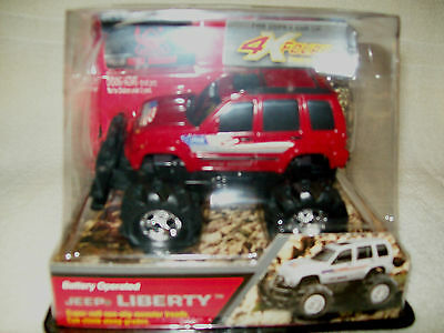 New Bright Red Jeep Liberty Battery Operated With Monster Treads, Mib
