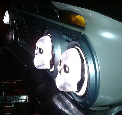 Skull headlight covers 5 3/4 inch 1 set of 4  for cars, trucks and some big rigs
