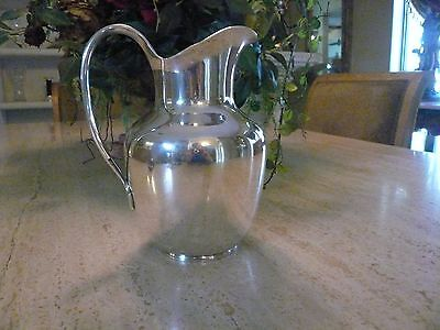 Sterling silver water pitcher by Cohr