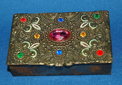 A slightly gothic small filigree decorated, enamelled and jewelled trinket box