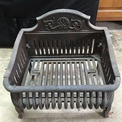 Black Cast Iron Fire Basket With Decorative Detail and Casters
