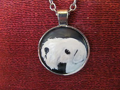 Sealyham Terrier hand painted on round, metal pendant/bead/necklace