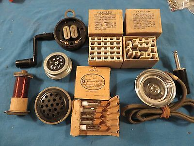 Vintage telephone parts,crank ,fuses,mouth piece,hearing device and etc.