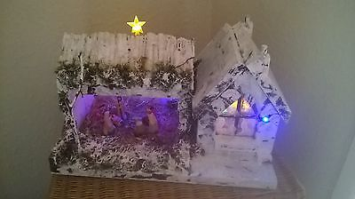 All wood hand made light up nativity.(large piece)