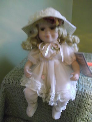 """Sunday Best 9"""" Porcelain sitting baby doll by Vanessa Ricardi rosettes & lace"""