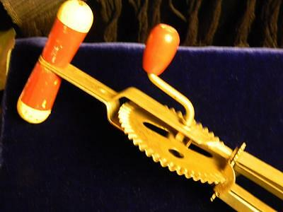 "Vintage Kitchen Beater/Mixer; ""High Speed Super Center Drive""; Red/White Handle."