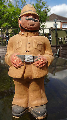 Papier mache policeman with removable head