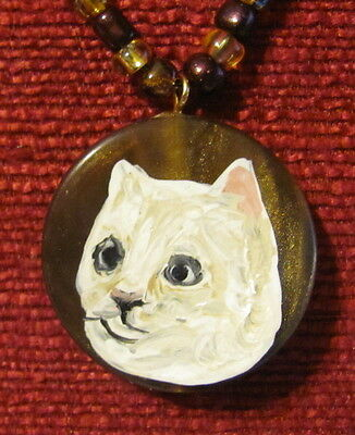 Cat - white shorthaired - hand painted on round, wavy pendant/bead/necklace