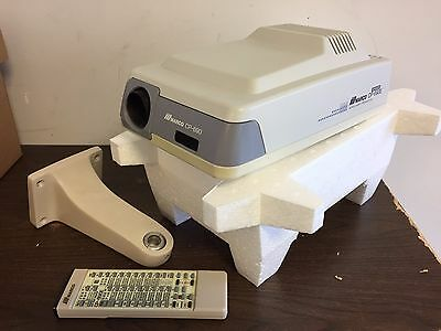 Marco/Nidek Auto Chart Projector, model CP-690 with remote control & wall mount.