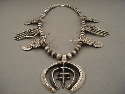 Opulent Navajo Tufa Casted Silver 'clown And Hand' Squash Blossom Necklace