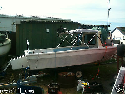 16 foot fishing boat with outboard pod can cuddy