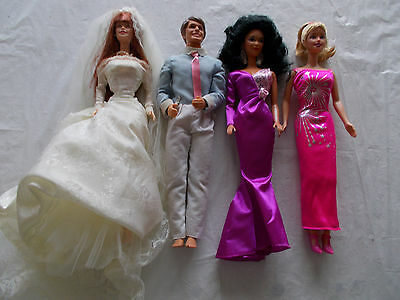4 Barbie Dolls with Clothing (LOT #8)