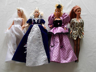 4 Barbie Dolls with Clothing (LOT #5)