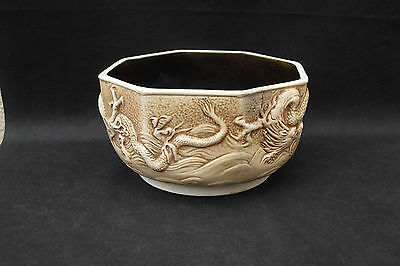 Bretby bas relief dragons bowl with brown glazed interior octagonal
