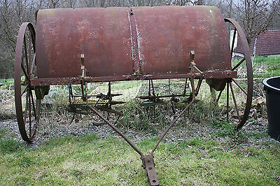 Antique agricultural haymaker haybob with iron wheels