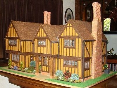 Large model of a Tudor House with furniture and accessories
