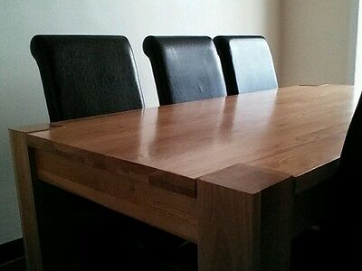 Kuba solid oak dining table and 6 faux leather chairs.